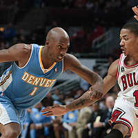 08 November 2010: Denver Nuggets' point guard #1 Chauncey Billups drives past Chicago Bulls' point guard #1 Derrick Rose during the Chicago Bulls 94-92 victory over the Denver Nuggets at the United Center, in Chicago, Illinois, USA.