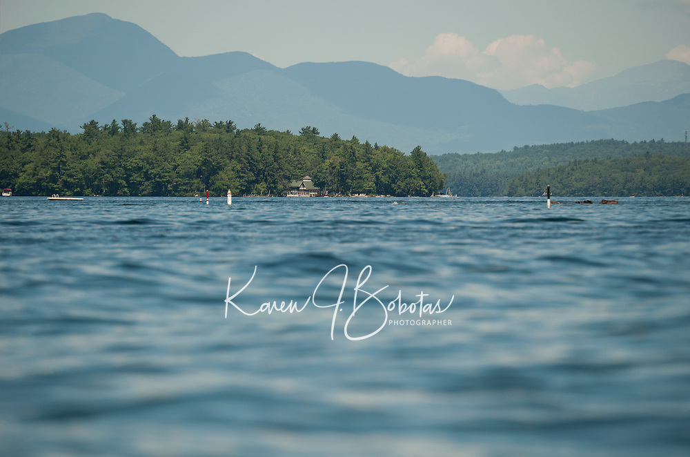 Kayaking on Lake Winnipesaukee.  ©2016 Karen Bobotas Photographer