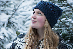 Close-up of a happy teenage girl daydreaming in winter, Bavaria, Germany