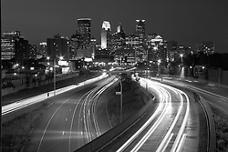 Black and White version of photograph of downtown Minneapolis skyline from above I-35W