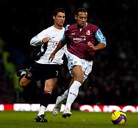Photo: Ed Godden.<br /> West Ham United v Manchester United. The Barclays Premiership. 17/12/2006. West Ham's Anton Ferdinand (R), keeps the ball from Cristiano Ronaldo.