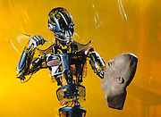 Entertainer android robot. View of SARCOS, an android (human-like) entertainment robot, posing as if about to contemplate his next brush stroke on a life-like robot mask. SARCOS was developed at SARCOS Research Corporation in Salt Lake City, Utah, USA. Photo-Illustration. Robo sapiens Project.