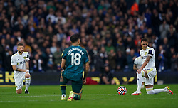 Leeds United's Rodrigo (right) takes the knee in support of the Black Lives Matter movement before the Premier League match at Elland Road, Leeds. Picture date: Saturday October 2, 2021.