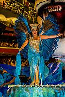 Performers on floats in the Carnaval parade of Unidos do Porto da Pedra samba school in the Sambadrome, Rio de Janeiro, Brazil.