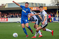 AFC Wimbledon midfielder Anthony Hartigan (8) battles for possession with Gillingham midfielder Callum Reilly (13) during the EFL Sky Bet League 1 match between AFC Wimbledon and Gillingham at the Cherry Red Records Stadium, Kingston, England on 23 March 2019.