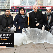 "Aamer Naeem, Baroness Warsi, Rt Revd Paul Hendricks and Shaykh Ibrahim Mogra attends Penny Appeal Team Orange unveiling 5 life-size ice statues ""What Would Jesus Do?"", symbolising homeless families to promote their winter campaign. The frozen family will depict the plight of the 140* families who become homeless everyday, and the 900* children who become homeless every month on 17th December at Canary Wharf, London, UK."