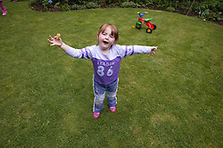 Young girl playing in the garden,