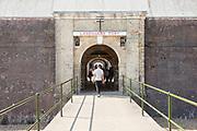Open entrance with people visiting Landguard Fort, Felixstowe, Suffolk, England, UK