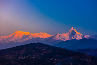 Peaks of the Annapurna Massif of the Himalayas seen at sunset from Lekhnath,  near Pokhara, Nepal.