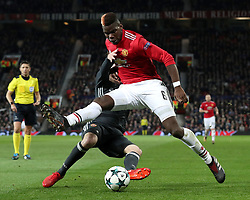 CSKA Moscow's Mario Fernandes (left) and Manchester United's Paul Pogba battle for the ball during the UEFA Champions League match at Old Trafford, Manchester.