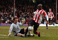 Photo: Olly Greenwood.<br />Brentford v Barnsley. Coca Cola League 1. 11/03/2006. Brentford's Isaish Rankin and Barnsley's Nick Colgan.