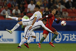 June 28, 2017 - Kazan, Russia - Cristiano Ronaldo (R) of Portugal national team vies for the ball with Mauricio Isla (L) of Chile national team and Gary Medel of Chile national team during FIFA Confederations Cup Russia 2017 semi-final match between Portugal and Chile at Kazan Arena in June 28, 2017 in Kazan, Russia. (Credit Image: © Mike Kireev/NurPhoto via ZUMA Press)