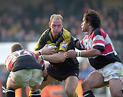 Wycombe. GREAT BRITAIN, 13th April 2003 Rugby Parker Pen European  Cup,  Causeway Stadium/ Adams Park, ENGLAND. Photo, Peter Spurrier/Intersport-images]<br /> <br /> 2003 -Rugby Parker Pen European  Cup <br /> London Wasps v Pontypridd<br /> Lawrence Dallaglio grips the ball with Jonathan Bryant and Richard Parks set themselves for the tackle