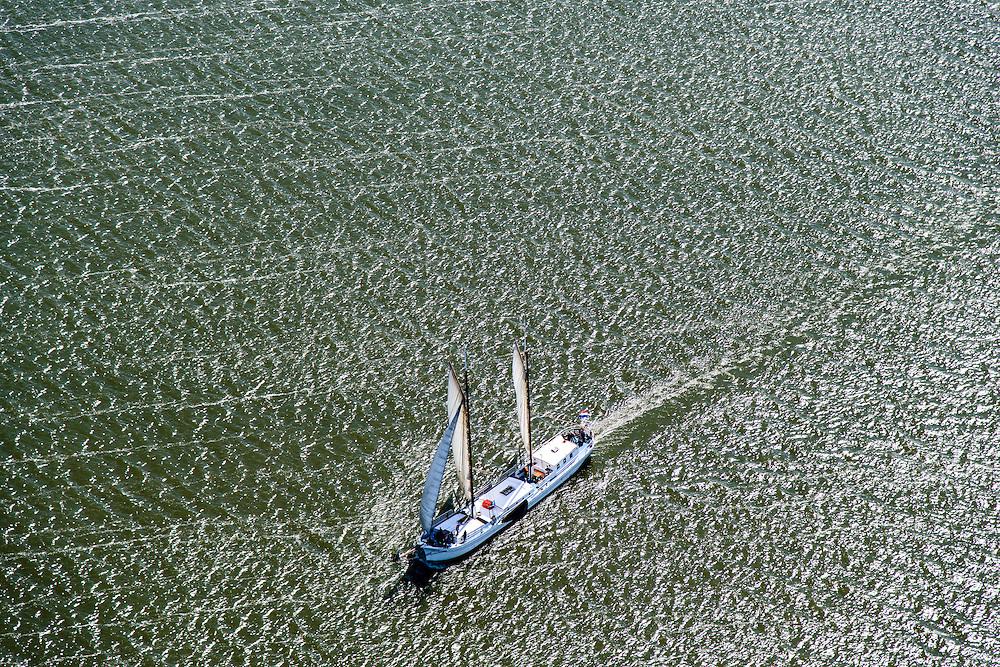 Nederland, Flevoland, Lelystad, 07-05-2015; tweemaster zeilt op IJsselmeer ten noorden van Lelystad, oostelijk van de Houtribdijk.<br /> Ketch sailing on the IJsselmeer north of Lelystad.<br /> <br /> luchtfoto (toeslag op standard tarieven);<br /> aerial photo (additional fee required);<br /> copyright foto/photo Siebe Swart