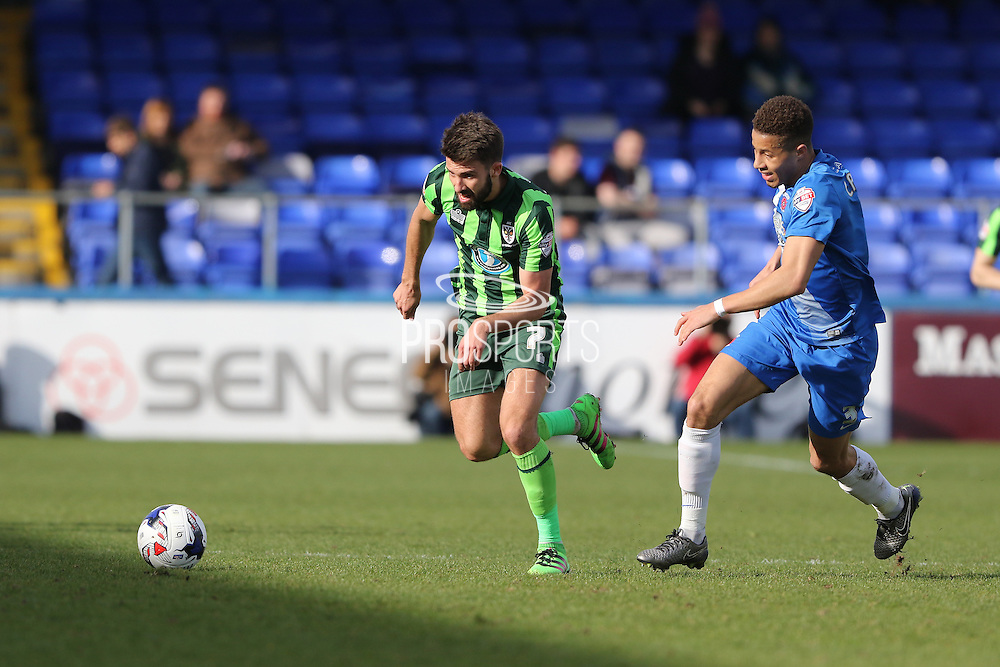 George Francomb midfielder for AFC Wimbledon (7) and Hartlepool United defender Jake Carroll (3) chase the ball during the Sky Bet League 2 match between Hartlepool United and AFC Wimbledon at Victoria Park, Hartlepool, England on 25 March 2016. Photo by Stuart Butcher.
