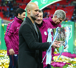 February 25, 2018 - London, England, United Kingdom - Manchester City manager Pep Guardiola with Trophy.during Carabao Cup Final match between Arsenal against Manchester City at Wembley stadium, London  England on 25 Feb 2018. (Credit Image: © Kieran Galvin/NurPhoto via ZUMA Press)