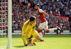 Arsenal's Olivier Giroud celebrates scoring the deciding penalty during the shoot out in the Community Shield at Wembley, London.