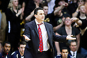 SHOT 2/14/13 10:36:05 PM - Arizona head basketball coach Sean Miller questions a call during their regular season Pac-12 basketball game against Colorado at the Coors Event Center on the Colorado campus in Boulder, Co. Colorado won the game 71-58. (Photo by Marc Piscotty / © 2013)