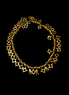 Bronze Age Hattian gold necklace from Grave TM, possibly a Bronze Age Royal grave (2500 BC to 2250 BC) - Alacahoyuk - Museum of Anatolian Civilisations, Ankara, Turkey. Against a black background .<br /> <br /> If you prefer to buy from our ALAMY PHOTO LIBRARY  Collection visit : https://www.alamy.com/portfolio/paul-williams-funkystock/royal-tombs-alaca-hoyuk-bronze-age.html (TIP refine search by adding background colour in the LOWER search box)<br /> <br /> Visit our ANCIENT WORLD PHOTO COLLECTIONS for more photos to download or buy as wall art prints https://funkystock.photoshelter.com/gallery-collection/Ancient-World-Art-Antiquities-Historic-Sites-Pictures-Images-of/C00006u26yqSkDOM