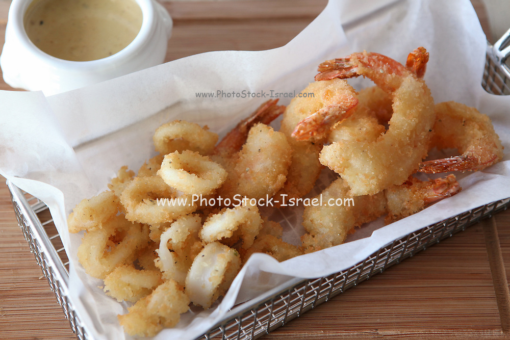 deep fried shrimps tempura served with a dip