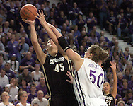 Colorado forward Jackie McFarland (45) scores past her sister Kansas State center Jessica McFarland (50) during the first half of K-State's 85-66 win over the Buffaloes at Bramlage Coliseum in Manhattan, Kansas, January 14, 2006.