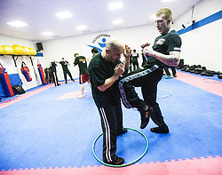 Alan knees inside the hoop, Stef Noij, KMG Instructor from the Institute Krav Maga Netherlands, takes the IKMS G Level Programme seminar today at the Scottish Martial Arts Centre, Alloa.