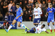Tottenham Hotspur midfielder Victor Wanyama (12) and Colchester United defender Cohen Bramall (3) battle for the ball during the EFL Cup match between Colchester United and Tottenham Hotspur at the JobServe Community Stadium, Colchester, England on 24 September 2019.