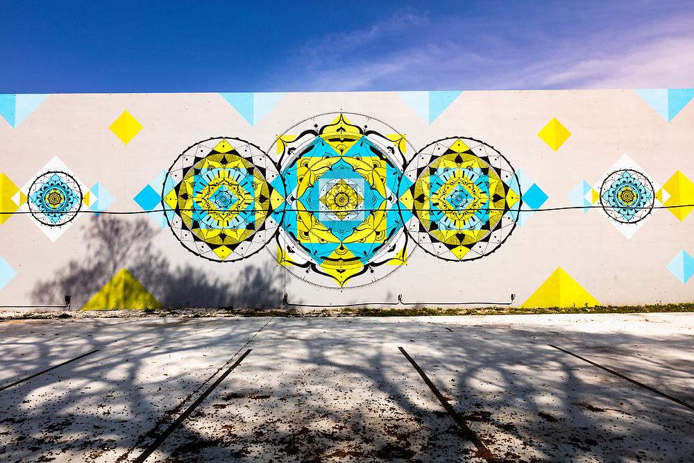 Cosmic, Buddhist-style mandalas on a mural in Miami's Wynwood street art district.