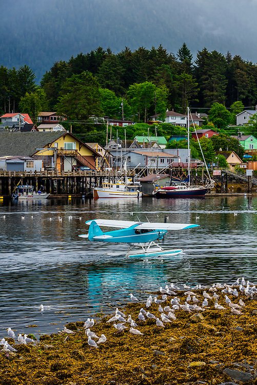 A floatplane taxiing in the harbor in Sitka, southeast Alaska USA.