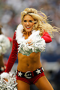 A Dallas Cowboys cheerleader performs during a timeout against the New Orleans Saints at Cowboys Stadium in Arlington, Texas, on December 23, 2012.  (Stan Olszewski/The Dallas Morning News)