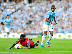 Manchester United's Danny Welbeck falls under the challenge from Manchester City's Fernandinho - Photo mandatory by-line: Dougie Allward/JMP - Tel: Mobile: 07966 386802 22/09/2013 - SPORT - FOOTBALL - City of Manchester Stadium - Manchester - Manchester City V Manchester United - Barclays Premier League