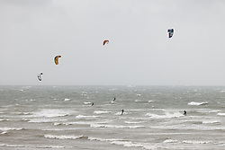 © Licensed to London News Pictures. 30/07/2021. Lancing, UK. Kite surfers make use of the high winds at Lancing in West Sussex. Parts of the south are feeling the effects of Storm Evert, the first named storm of summer 2021. Photo credit: Peter Macdiarmid/LNP