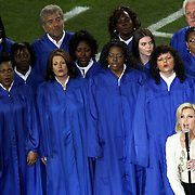 Faith Hill sings national anthem prior to the Superbowl.