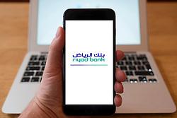 Using iPhone smart phone to display website logo of Riyad Bank from Saudi Arabia