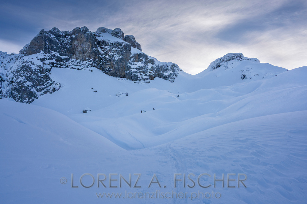 Three ski tourers on the way up to Blüemberg, Riemenstaldnertal, Schwyz, Switzerland