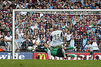 Photo: Chris Ratcliffe.<br />Liverpool v West Ham United. The FA Cup Final. 13/05/2006.<br />Bobby Zamora of West Ham misses as Jose Reina of Liverpool saves.