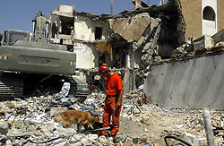 Turkish search and rescue teams comb the site of the explosion for bodies at the Canal Hotel in Baghdad, Iraq on Aug. 21, 2003. Earlier in the week a cement truck packed with explosives detonated outside the offices of the UN headquarters in Baghdad, Iraq, killing 20 people and devastating the facility in an unprecedented suicide attack against the world body. At least 100 people were wounded.