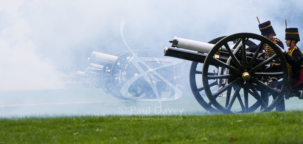 Hyde Park, London, June 2nd 2016. Soldiers and guns of the King's Troop Royal Horse Artillery fire a 41 round Royal Salute to mark the 63rd anniversary of the coronation of Britain's Monarch HM Queen Elizabeth II. PICTURED: Smoke from the guns blankets the scene.