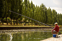 Bicycling along the Canal d'Ourcq, near Paris -fishing at Pavillons sur Bois...September 17, 2012..Photograph by Owen Franken for the NY Times