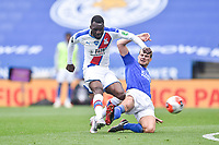LEICESTER, ENGLAND - JULY 04: Christian Benteke of Crystal Palace with a strike on goal despite a challenge from Ryan Bennett of Leicester City during the Premier League match between Leicester City and Crystal Palace at The King Power Stadium on July 4, 2020 in Leicester, United Kingdom. Football Stadiums around Europe remain empty due to the Coronavirus Pandemic as Government social distancing laws prohibit fans inside venues resulting in all fixtures being played behind closed doors. (Photo by MB Media)