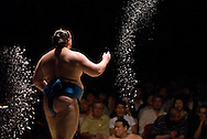 Baruto throws salt into the ring prior to his match against Dejima in the second round of Day 1 of Grand Sumo Tournament Los Angeles 2008, Los Angeles Sports Arena, Los Angeles, California