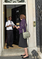 ©under licence to London News Pictures. 18/05/11. London, UK  . Campaigners from Lewisham, Camden & Swindon assembled to protest against the cuts at Department of Culture, Media and Sport, and then delivered a petition to 10 Downing Street. Picture shows Patricia Richardson from Lewisham handing in the petition to No 10. Please see special instructions for usage rates. Photo credit should read TONY NANDI/LNP