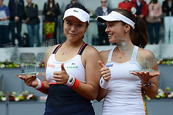May 13, 2017 - Madrid, Spain - YUNG-JAN CHAN of Tapei and MARTINA HINGIS of Switzerland pose with their trophies after winning the doubles title in the Mutua Madrid Open tennis tournament. (Credit Image: © Christopher Levy via ZUMA Wire)