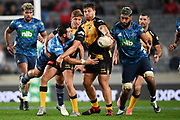 Harry Plummer tries to offload Akira Ioane in the tackle of to Domingo Miotti.<br /> Blues v Force, Sky Super Rugby Trans-Tasman. Eden Park, Auckland. New Zealand. Saturday 12 June 2021. © Copyright Photo: Andrew Cornaga / www.photosport.nz