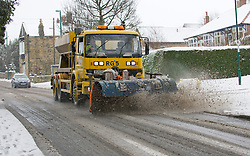 © Licensed to London News Pictures. 13/03/2013..North Yorkshire, England..A snow plough clears the main high street in Brotton as heavy snow continues to fall over North Yorkshire. ..Photo credit : Ian Forsyth/LNP