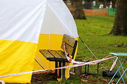 © Licensed to London News Pictures. 06/12/2019. London, UK. A park bench is seen within  police forensic tent in Chestnuts Park, Harringay, north London, opposite  Chestnuts Park Primary School, where a 14-year-old girl was allegedly raped. <br /> The victim was allegedly approached by a man who tried to engage her in conversation before raping her. Police were called just after 7 pm on Thursday, 5 December 2019. Photo credit: Dinendra Haria/LNP