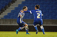 Brighton and Hove Albion Women's striker Charlotte Gurr scores a second for Brighton and celebrates with Brighton and Hove Albion Women's defender Charley Boswell during the FA Women's Premier League match between Brighton Ladies and Charlton Athletic WFC at the American Express Community Stadium, Brighton and Hove, England on 6 December 2015.