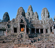 The Temple of Bayonne near Angkor was built by the ruler Jayavarman VII between 1181 and 1200 A.D.  It features stone carvings of Buddha faces on the towers of the third level and it is still a working monastery.