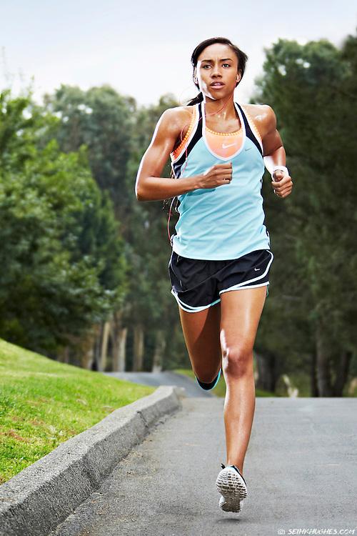 A woman runs through a residential neighborhood.
