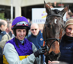File photo dated 08-01-2007 of Latest Exhibition and jockey Bryan Cooper. Paul Nolan has yet to decide whether to keep stable star Latest Exhibition over fences or revert to hurdling this winter. Issue date: Monday October 11, 2021.